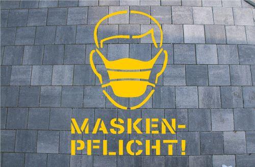 Maskenpflicht Bodenmarkierung
